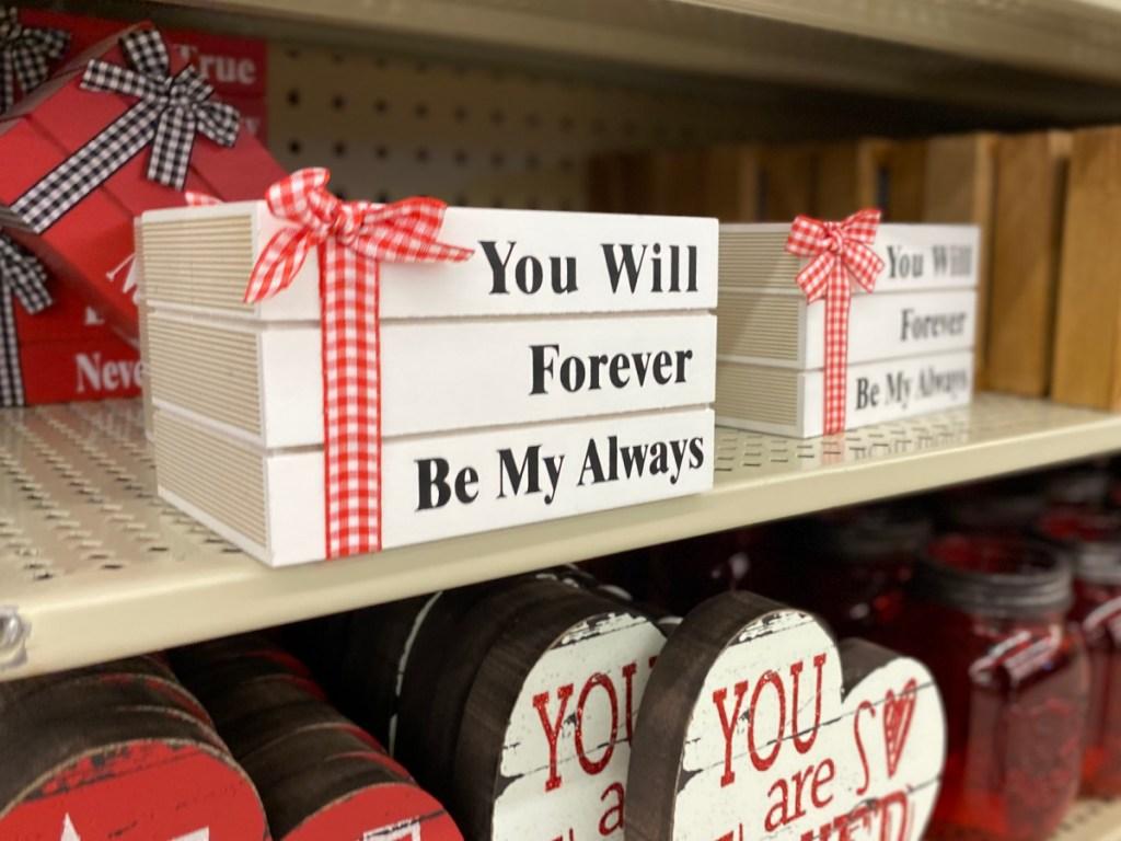 fake stack of valentine books sign at hobby lobby