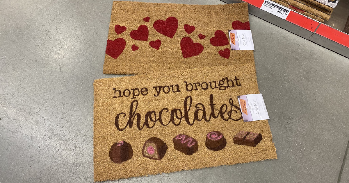 two coir rugs with valentines day designs laying on an aldi floor