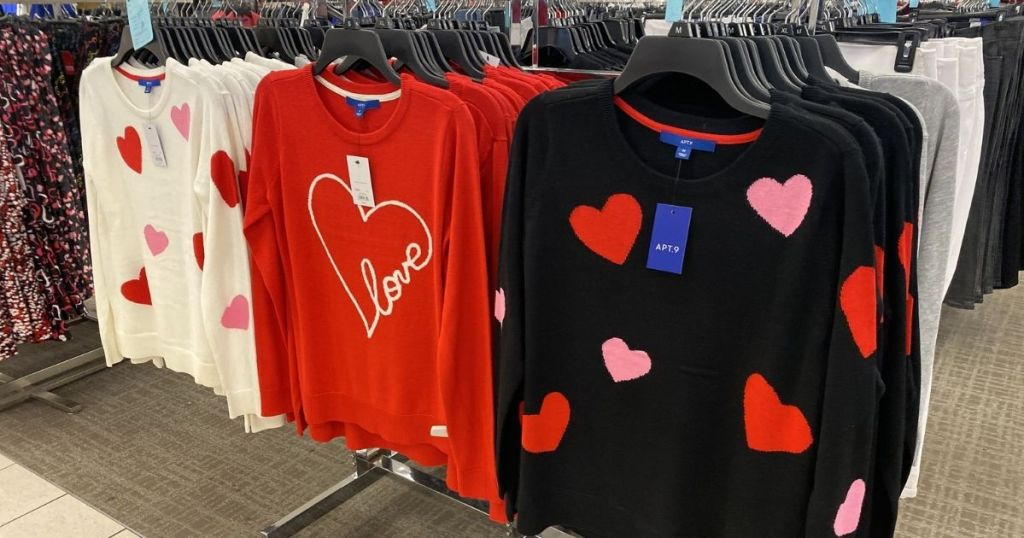 Valentine's Day sweaters hanging in store