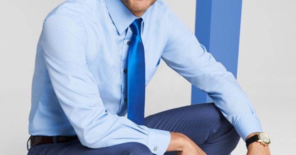man wearing blue dress shirt