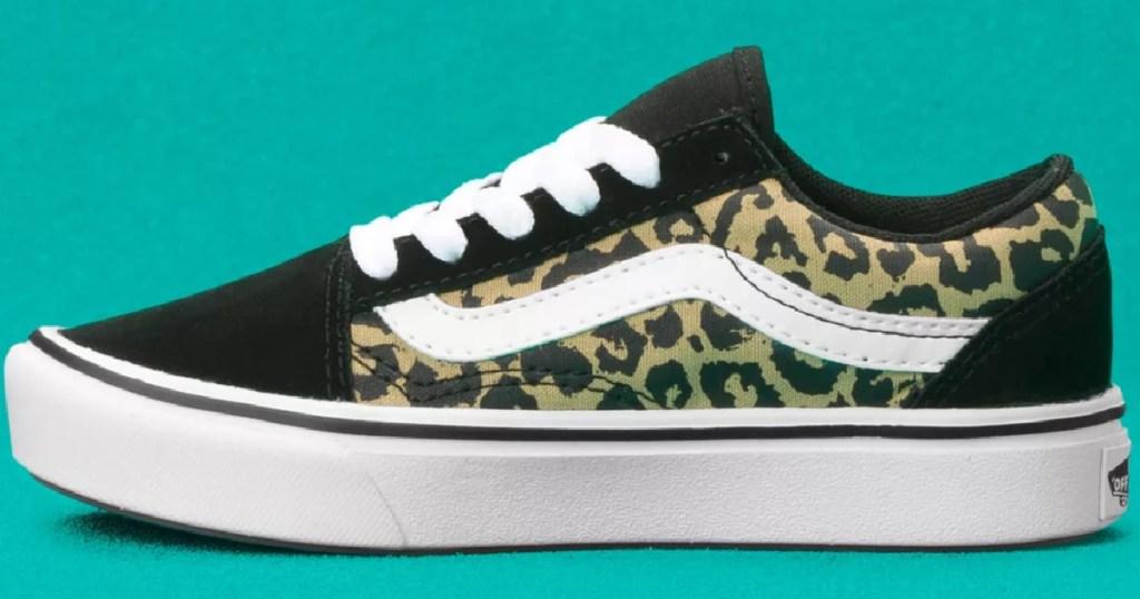 leopard and black pair of vans