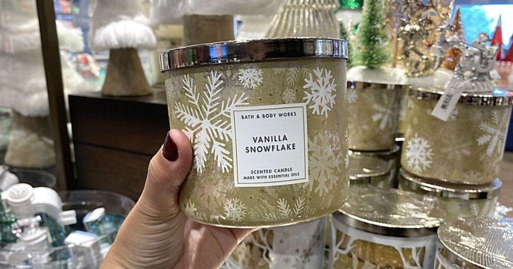 hand holding Vanilla Snowflake Candle