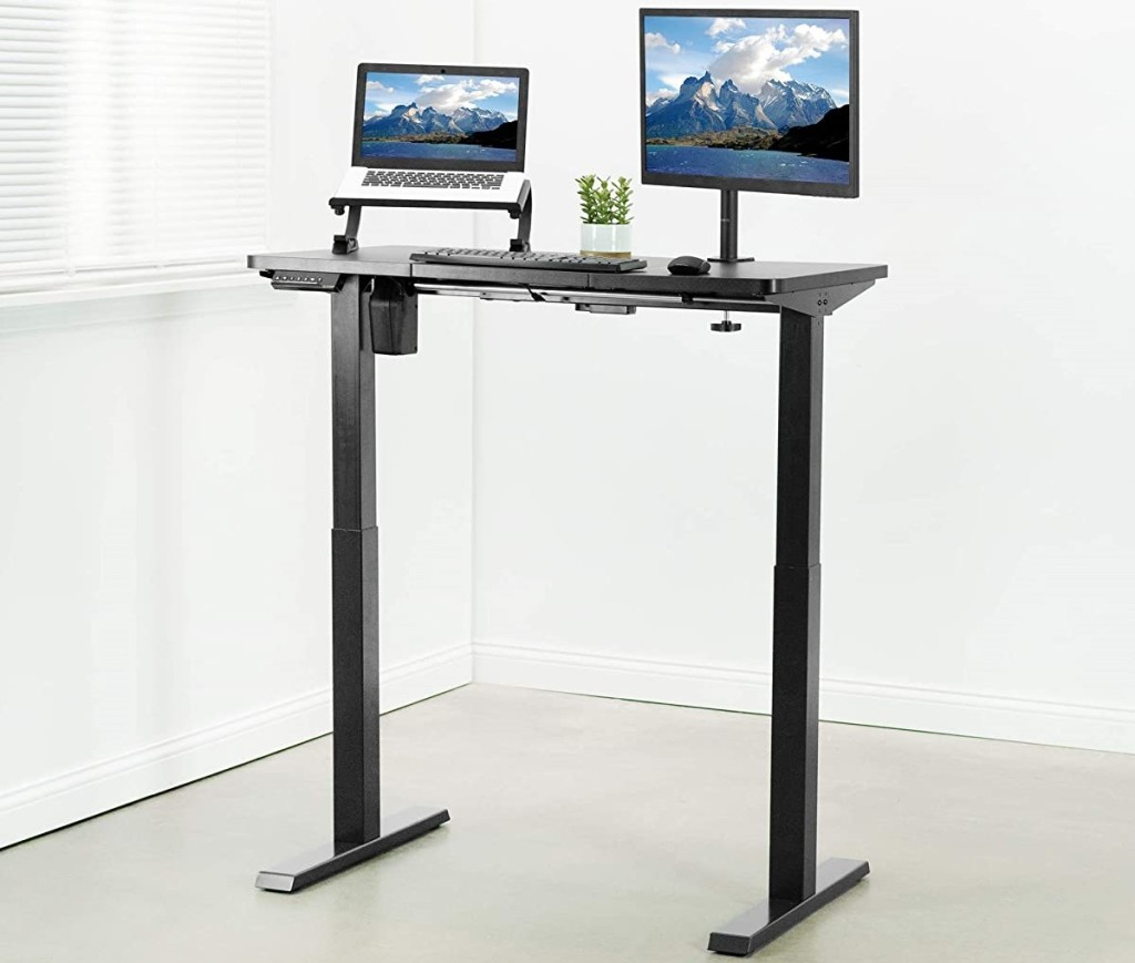 standing desk with a computer on it