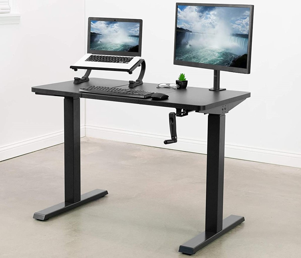 desk with two computers on it