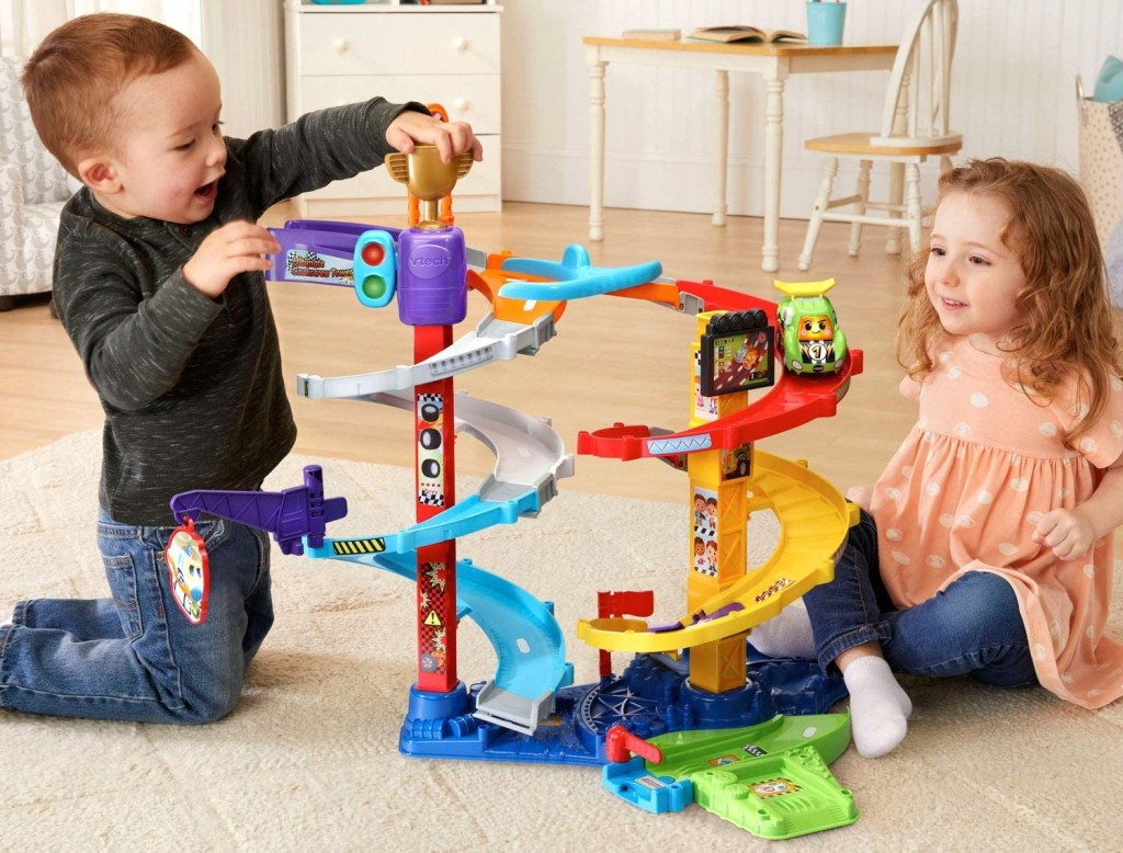 kids playing with a car playset