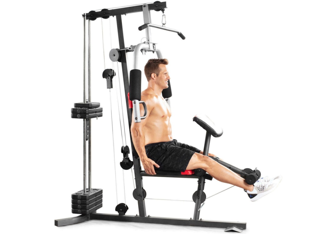 man working out on a home gym system