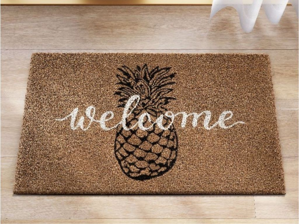 Welcome Doormat with a pineapple on it