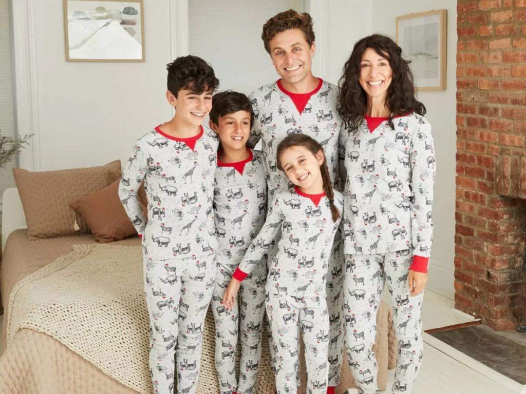 family all wearing Wondershop Holiday Safari Animal Print Matching Family Pajama Set