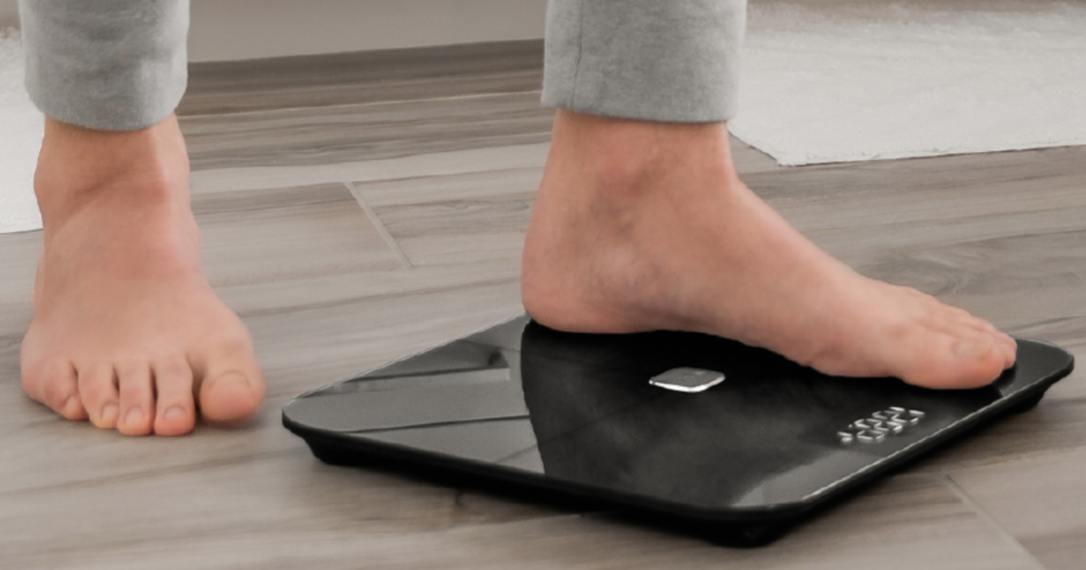 man stepping onto a black digital scale