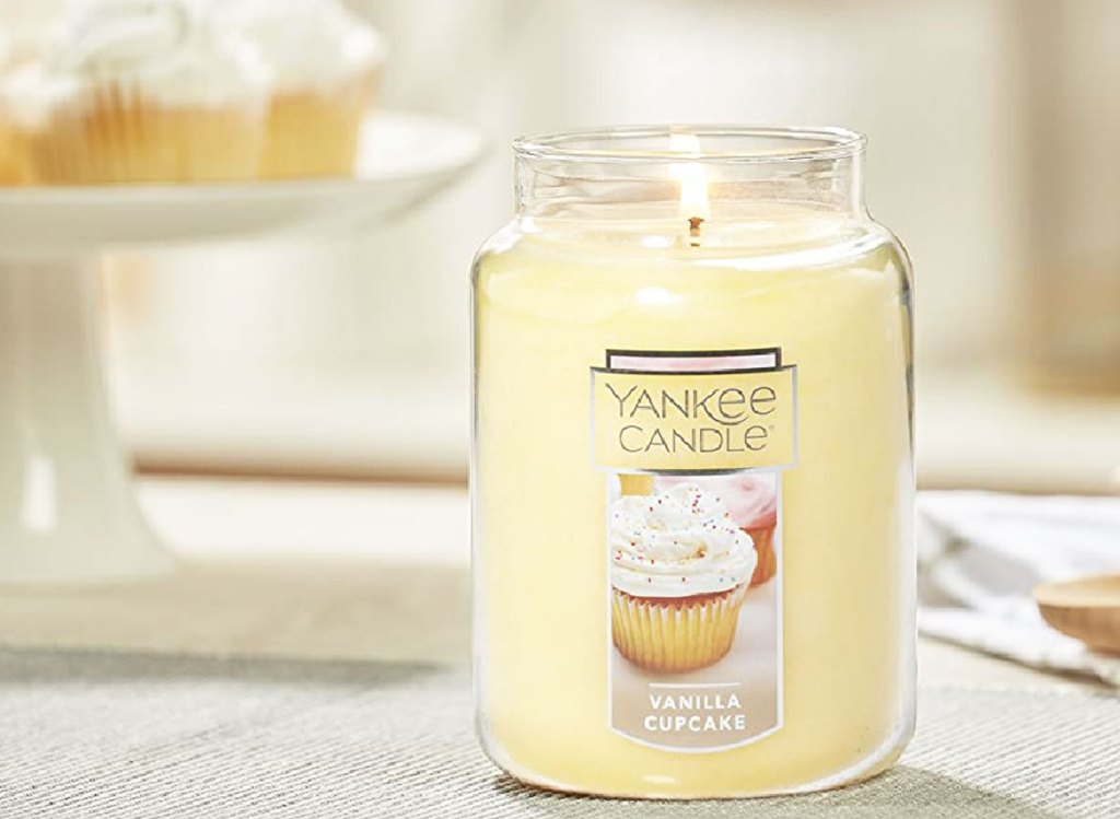 large white yankee candle in vanilla cupcake scent