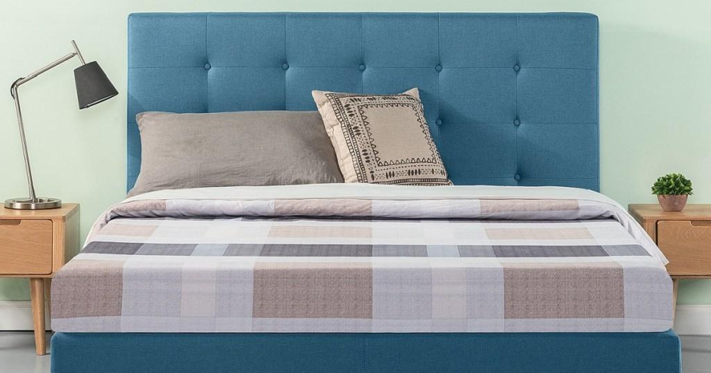 blue upholstered Zinus king size bed frame