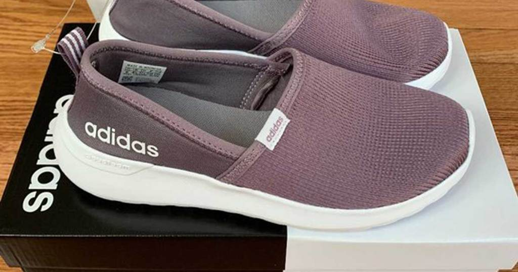 purple adidas racer lite shoes on a shoe box