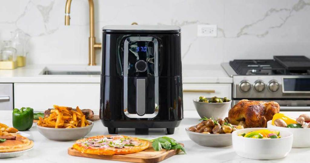 air fryer on counter with foods