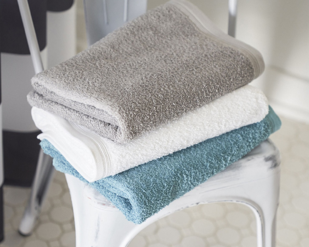 bath towels stacked on a chair