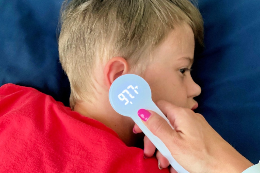 boy with thermometer to ear