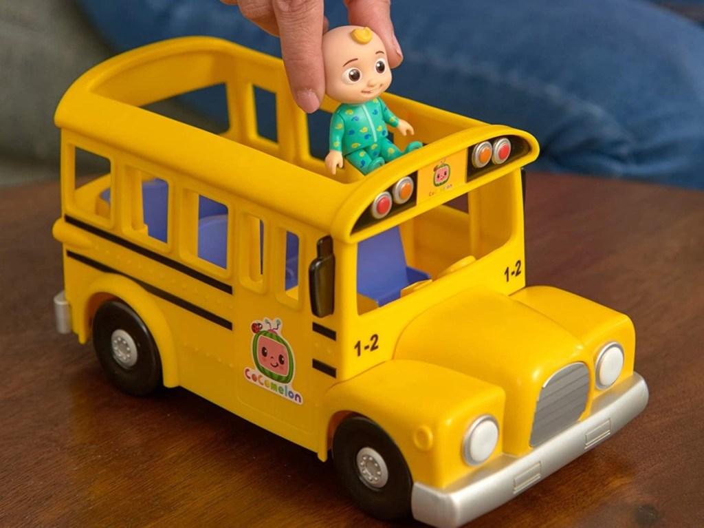 putting JJ figure into Cocomelon school bus