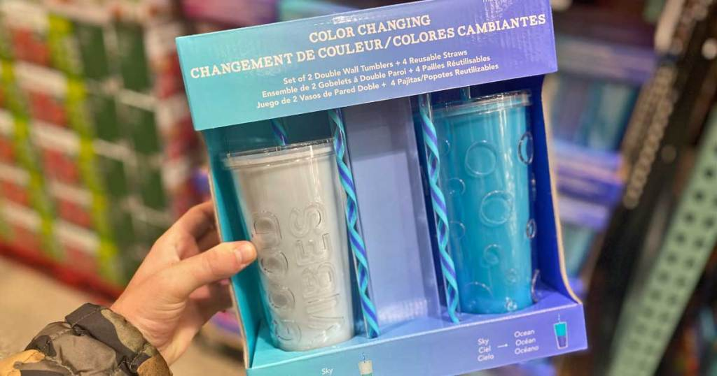 hand holding color changing tumblers in packages at costco
