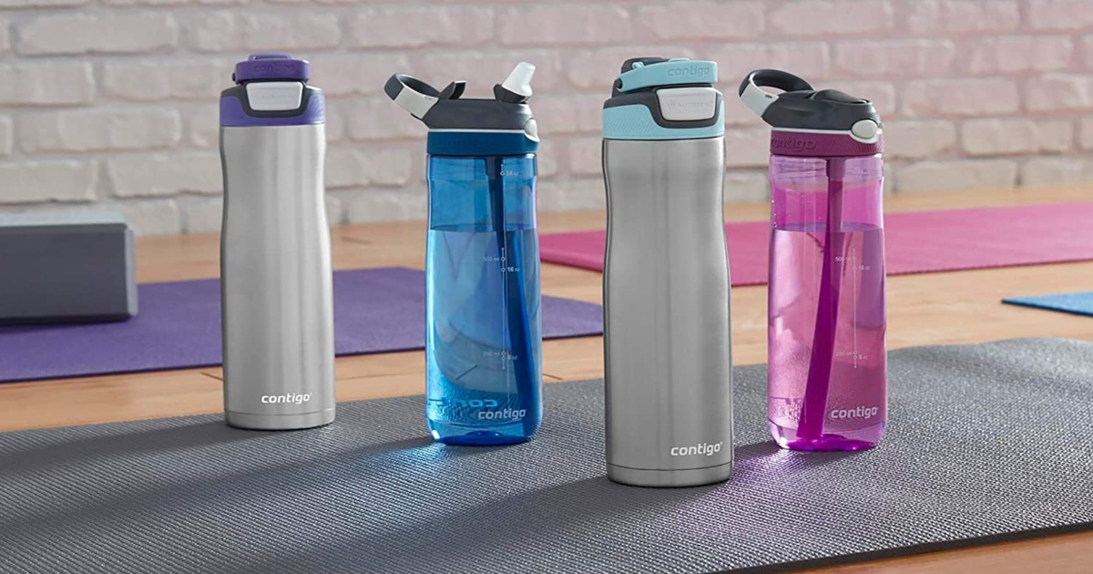 Contigo water bottles of different styles set up on a workout mat on the floor