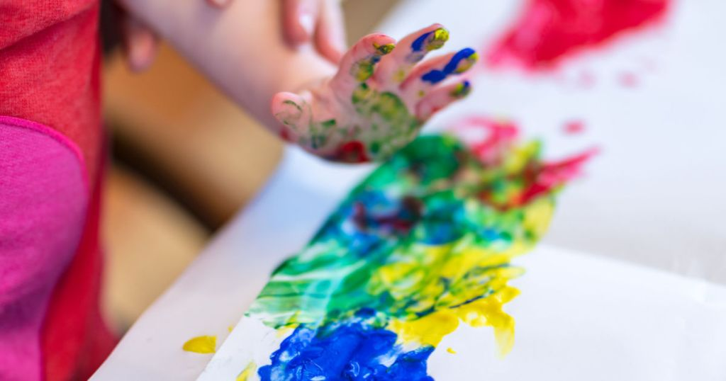 hand of child who is fingerpainting