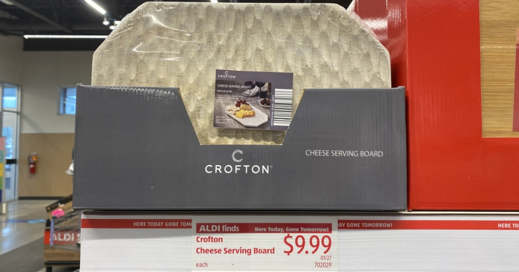 shelf with crofton cheese serving board