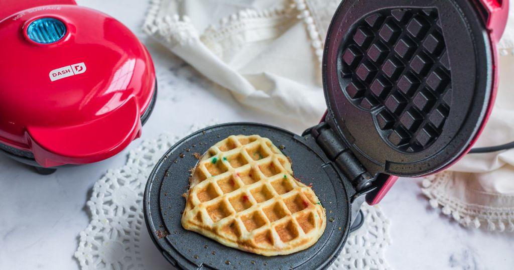 waffle maker open to show heart shaped waffle