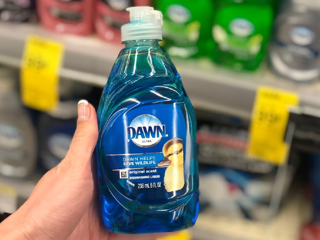 hand holding bottle of dish liquid in store