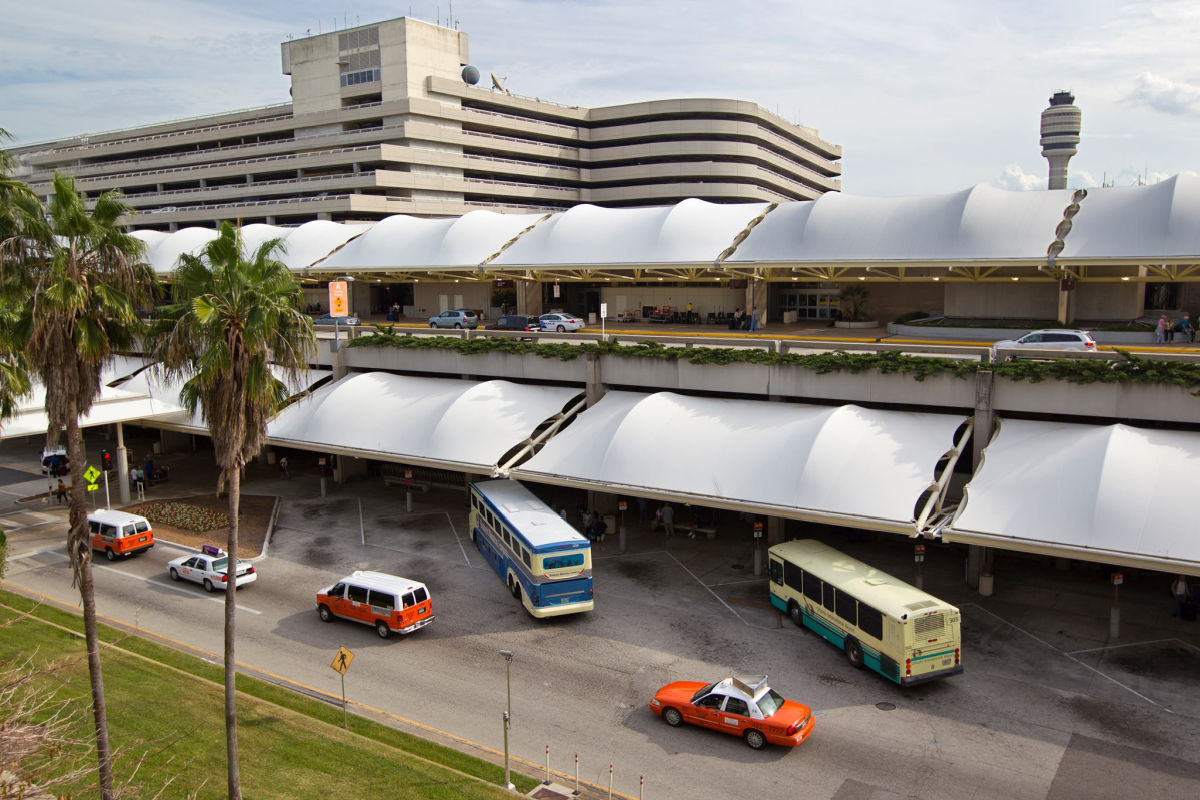 taxis and buses parked outside airport