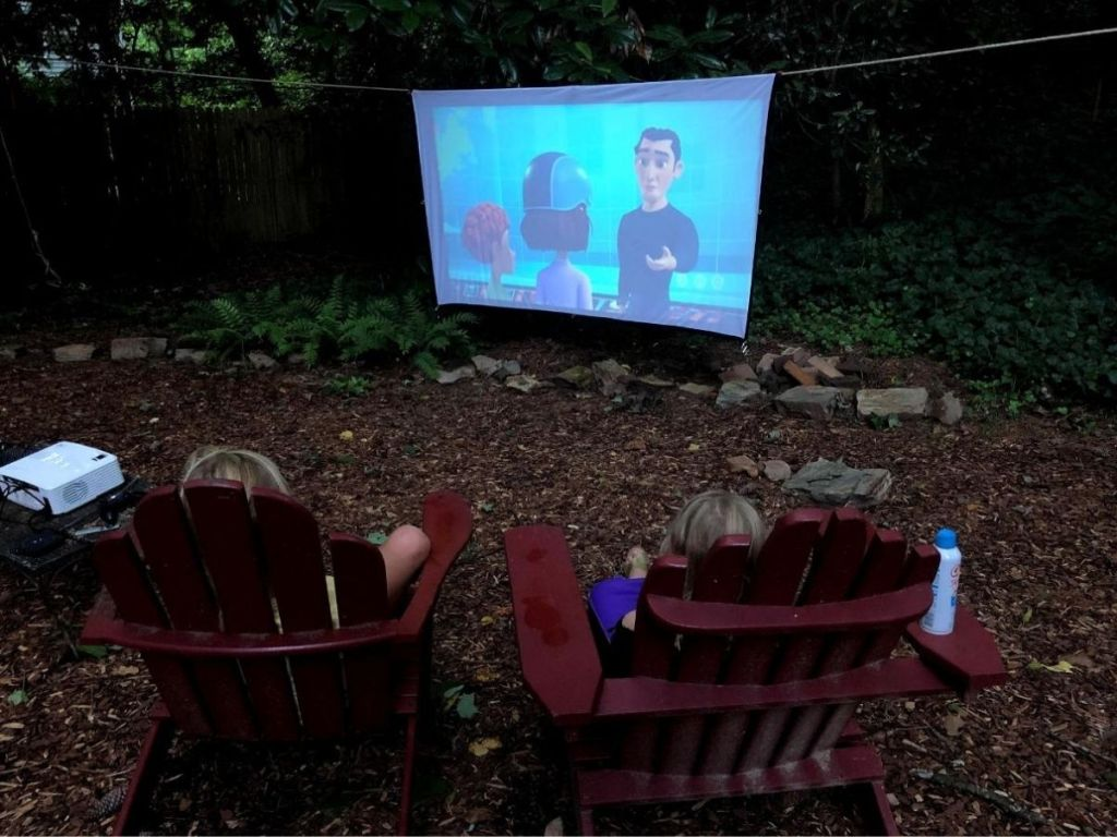 projector set up outside with projector screen