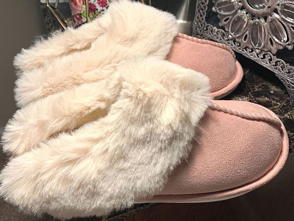 white and pink fuzzy slippers