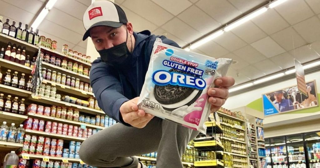 man holding package of double stuf gluten free oreos