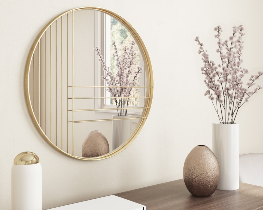 gold circle mirror on wall with geometric lines