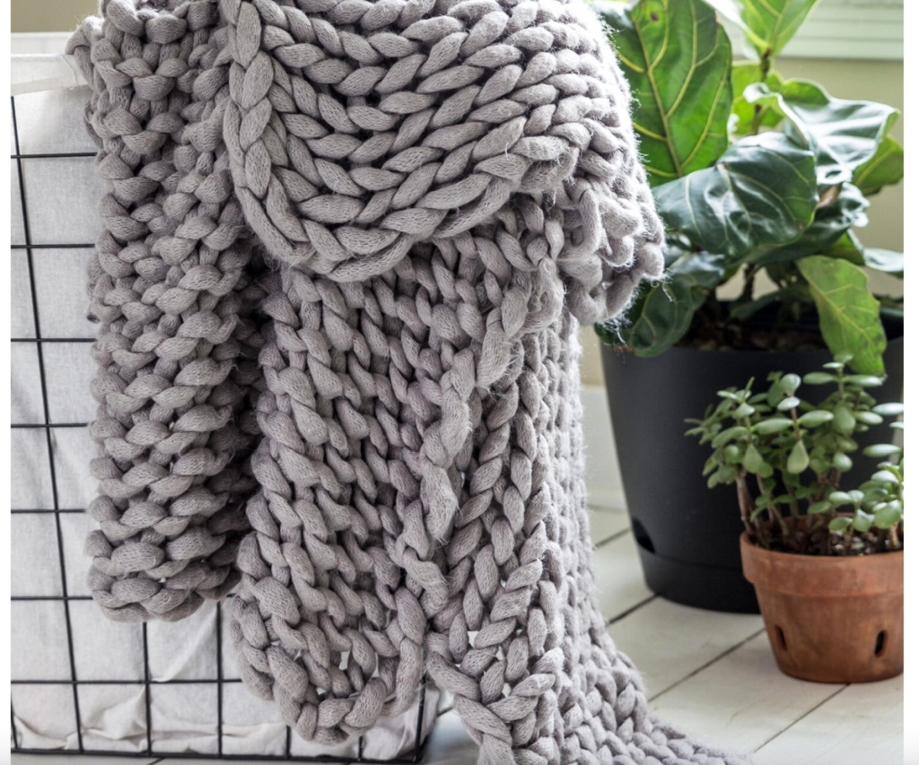 grey knit blanket in basket