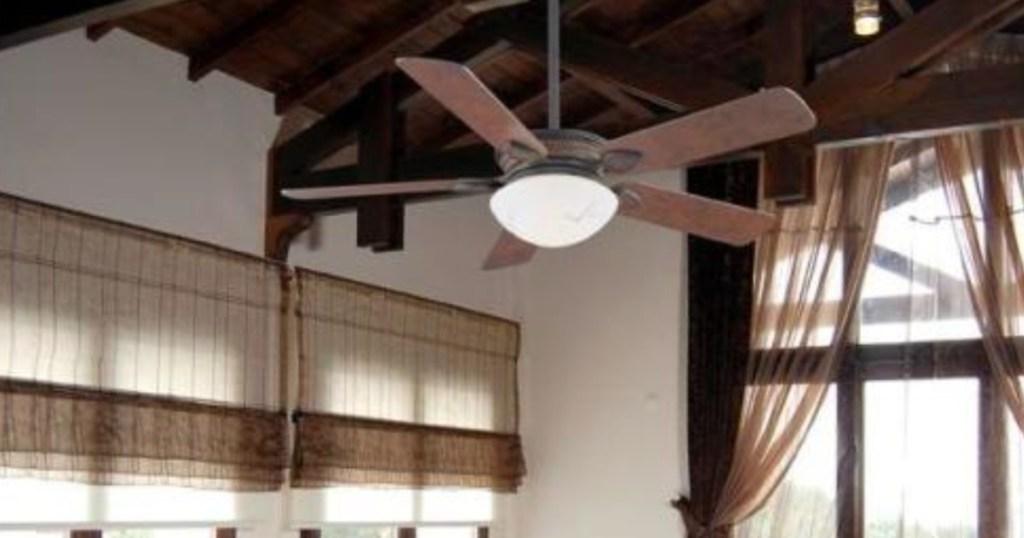 hampton bay rustic fan hanging above living room