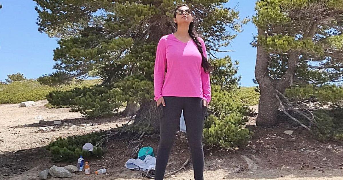 woman wearing pink tee outdoors