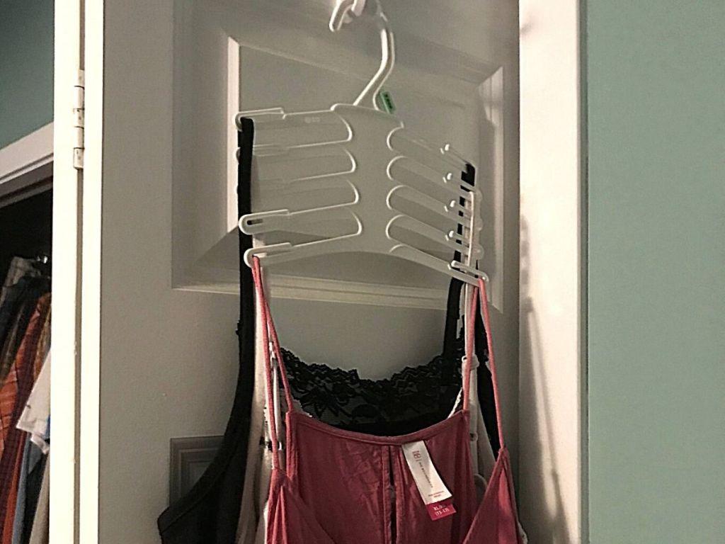 tank tops on hanger on closet door