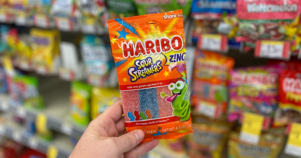 hand holding package of haribo sour streamers