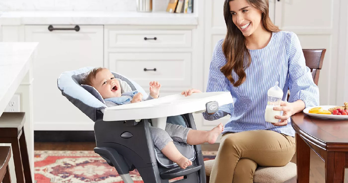 mom with baby in high chair in kitchen