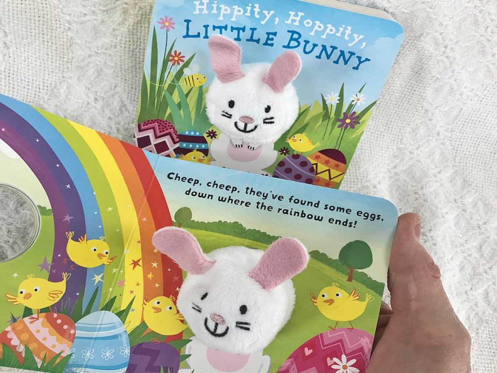 hand holding up board books with bunnies