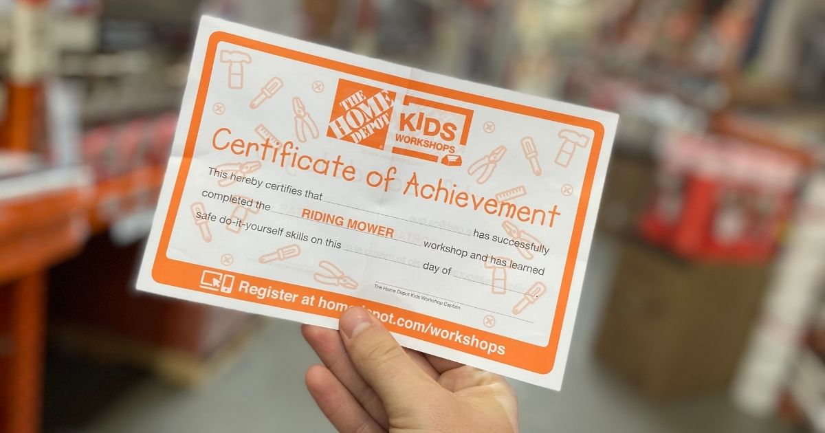 hand holding the home depot kids workshop certificate of completion certificate