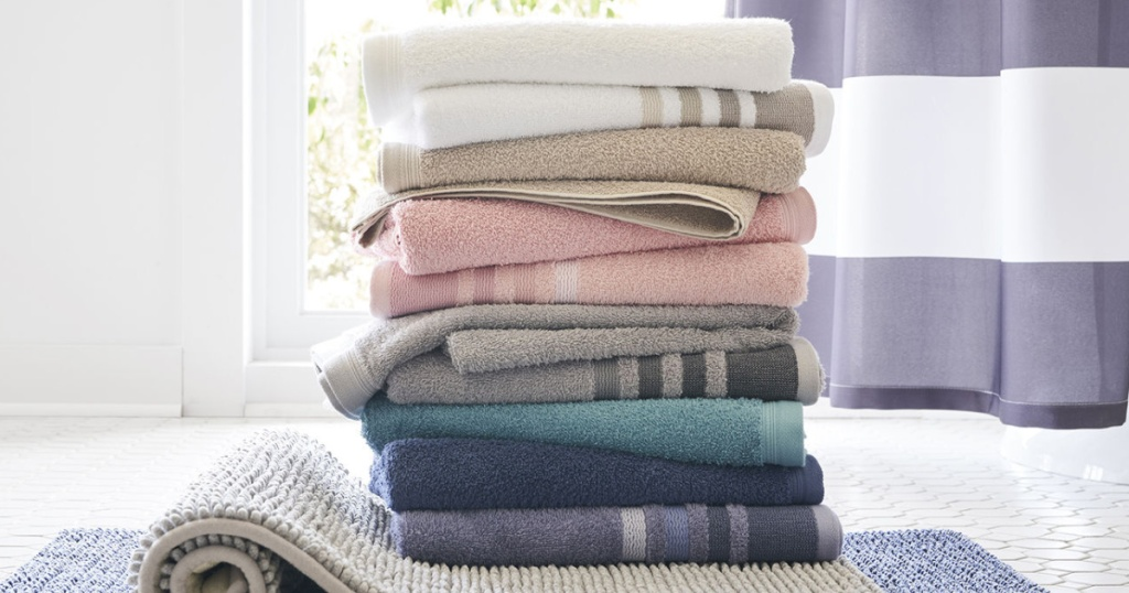 home expressions bath towels stacked in many colors