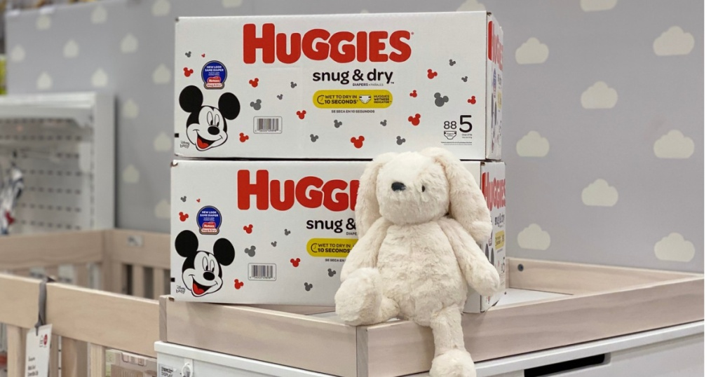 huggies snug & dry diapers stacked on top of a crib
