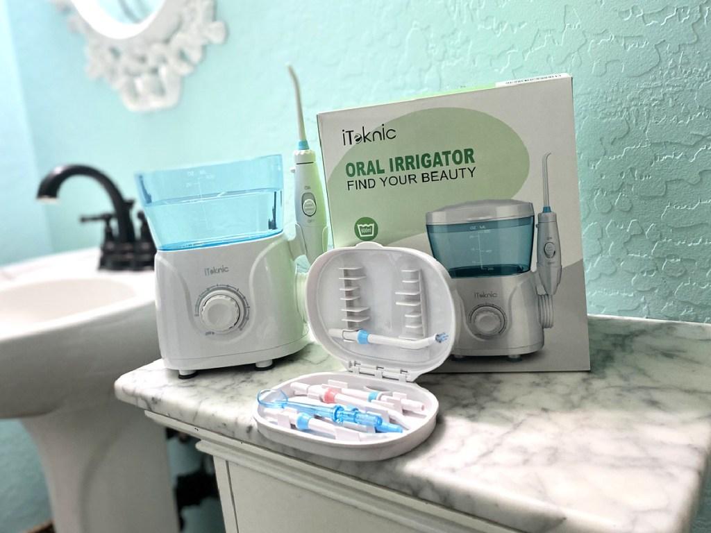 iTeknic Water Flosser on bathroom counter