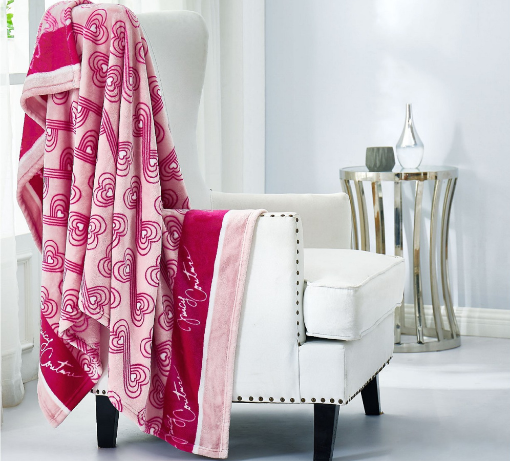 pink geo hearts throw over white chair
