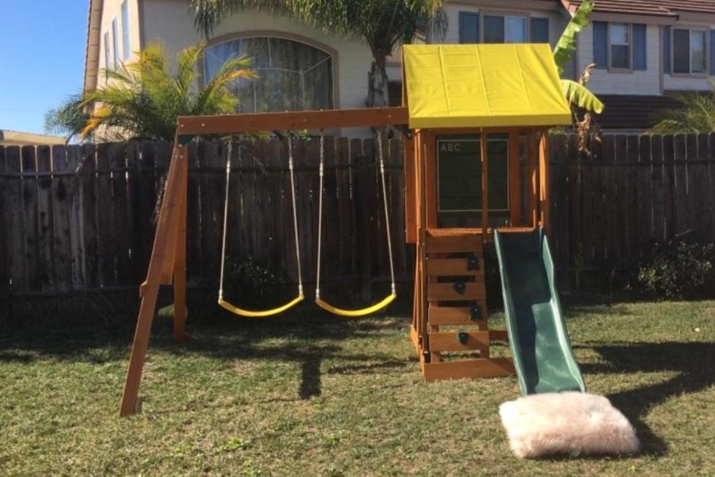 kidkraft appleton swingset in backyard
