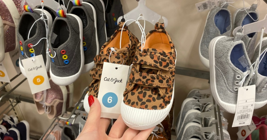 cat & jack kids sneakers in hand in store at target
