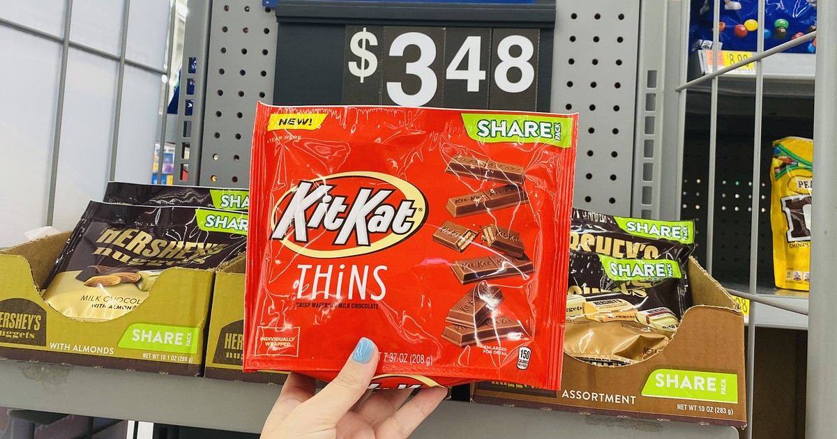 holding package of Kit Kat thins at Walmart