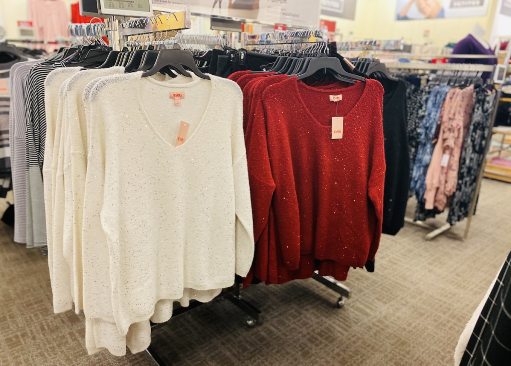 white and red sweaters on store rack