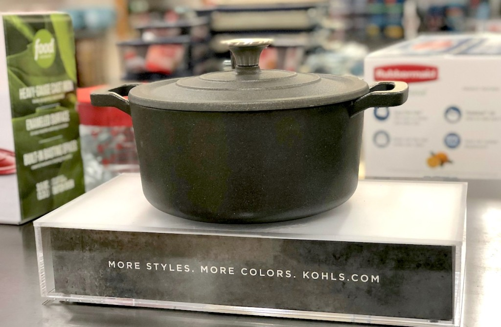 black cast iron dutch oven sitting on store display