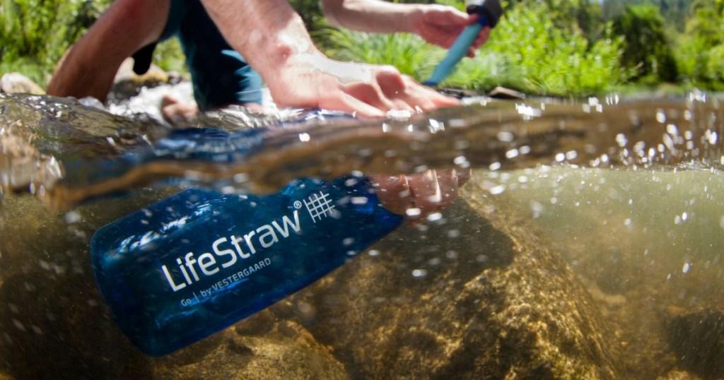 life straw water bottle in stream