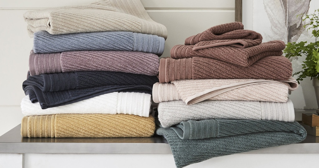 linden bath towels stacked in many colors